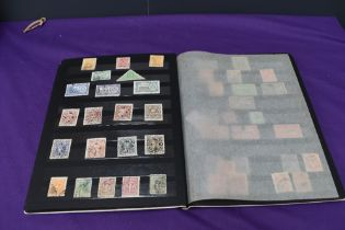 A Stock Book containing Indian Stamps, Queen Victoria to 1960's, mainly used
