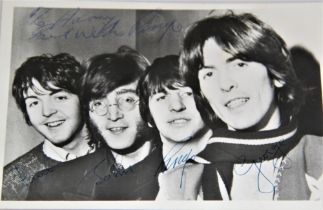 A Beatles signed photo - looks like 1965 / 1966 - dedicated to Harry - all four signatures present -