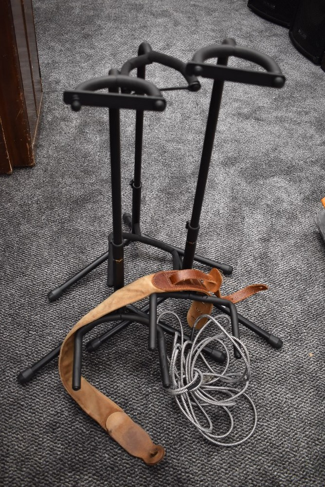 A selection of guitar stands, leads etc