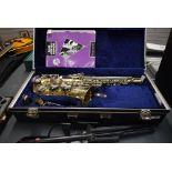 An AK Amatikraslice Alto Saxophone , model AAS 22 , hard case and folding stand
