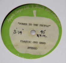 A test pressing of ' Power to People ' by John Lennon / Plastic Ono Band - super rare item and has