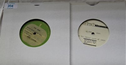 Two test pressings - one is Mary Hopkins on Apple -the other is unknown and sounds like early 1970's