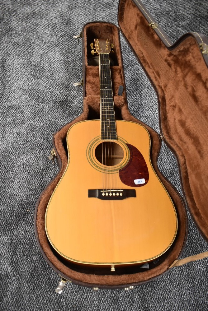 A Tanglewood acoustic guitar, in plush lined hard case, serial number 98034976