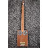 A cigar box style guitar, three string