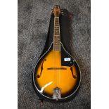 A Chord mandolin, sunburst with padded gig bag