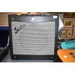 A Fender Mustang 110W combo amplifier (DSP)
