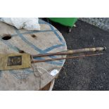 A vintage two piece 9ft 6inch cane fly rod in Hardy sleeve,unmarked.