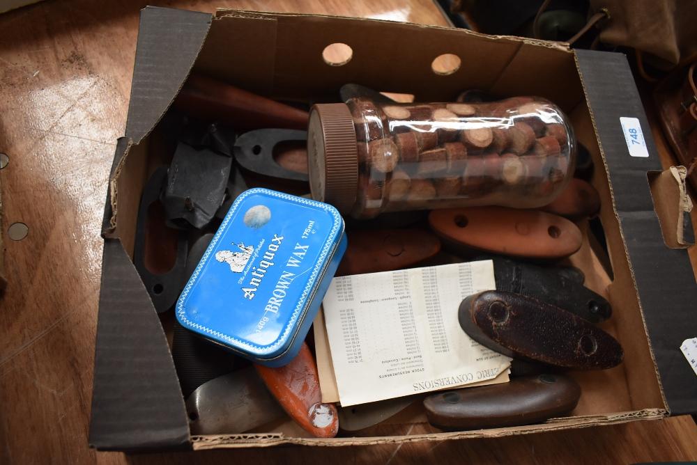 A box of gun butts and jar of cartridge wadding
