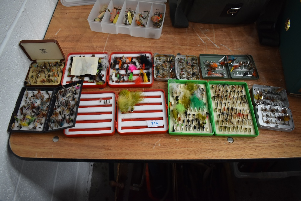A large selection of fishing flies in metal and plastic fly boxes.