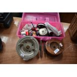 Two large vintage reels and an assortment of fly tying equipment.
