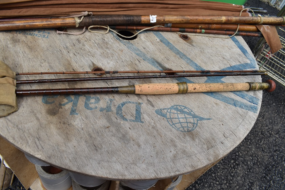 An 11ft Gow of Dundee three piece fly rod with spare tip and sleeve
