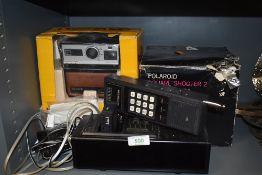 Two instant Polaroid cameras including Kodak EK100 and Polaroid Square shooter 2 in box