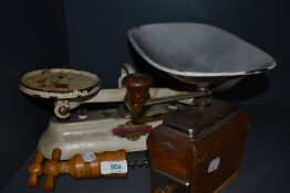 A selection of kitchen wares including coffee grinder and balance scale set