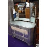 An Art Deco aluminium bedroom suite comprising large and small wardrobes, and dressing table, part