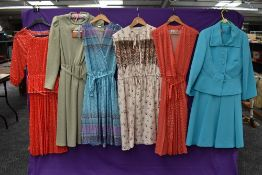 A mixed lot of vintage and retro dresses including one still having tags.predominantly 1970s,mixed