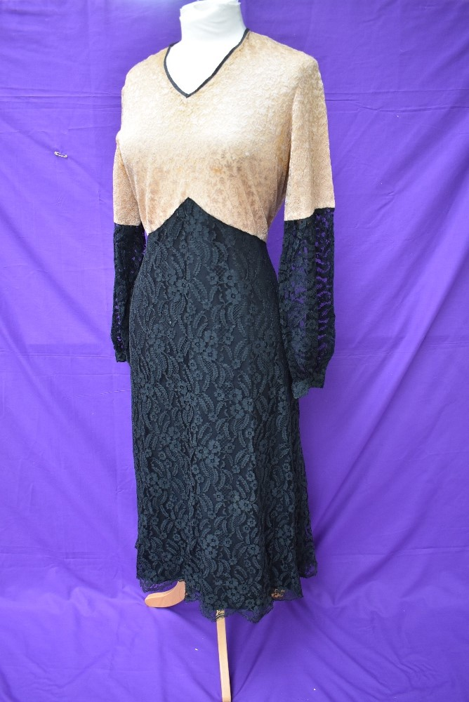 A 1930s black and taupe lace dress having silk lining and belted waist.