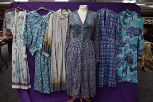 A collection of vintage and retro Ladies clothing in a mixture of colours,styles and eras