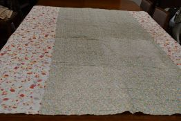 A large vintage quilt having floral section used throughout and backed in white cotton.