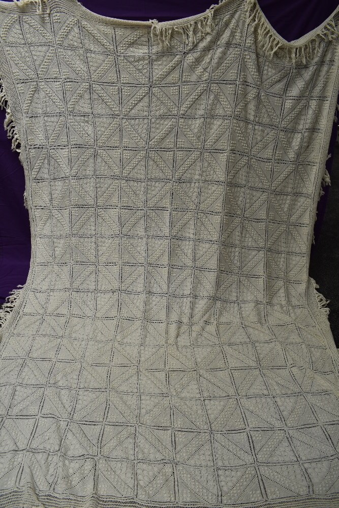 A beautiful antique throw having very finely knitted panels with leaf pattern and bobble details