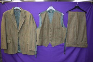 A three piece tweed suit by Bob Parratt, larger size.