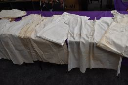 A good quantity of Victorian nightdresses,shifts, camisoles and aprons,some age staining.