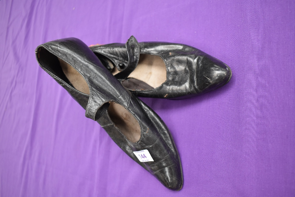 A pair of antique black leather shoes. - Image 2 of 4