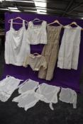 A collection of antique Victorian and Edwardian white wear including bodice,petticoats,camisole,