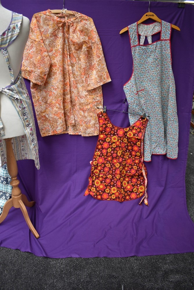 A lovely collection of aprons and overalls, some having original packaging and a lot appearing - Image 6 of 9
