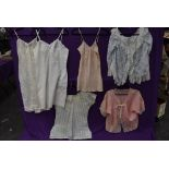 A selection of vintage and antique ladies lingerie and nightwear including camisole,lace edged bed