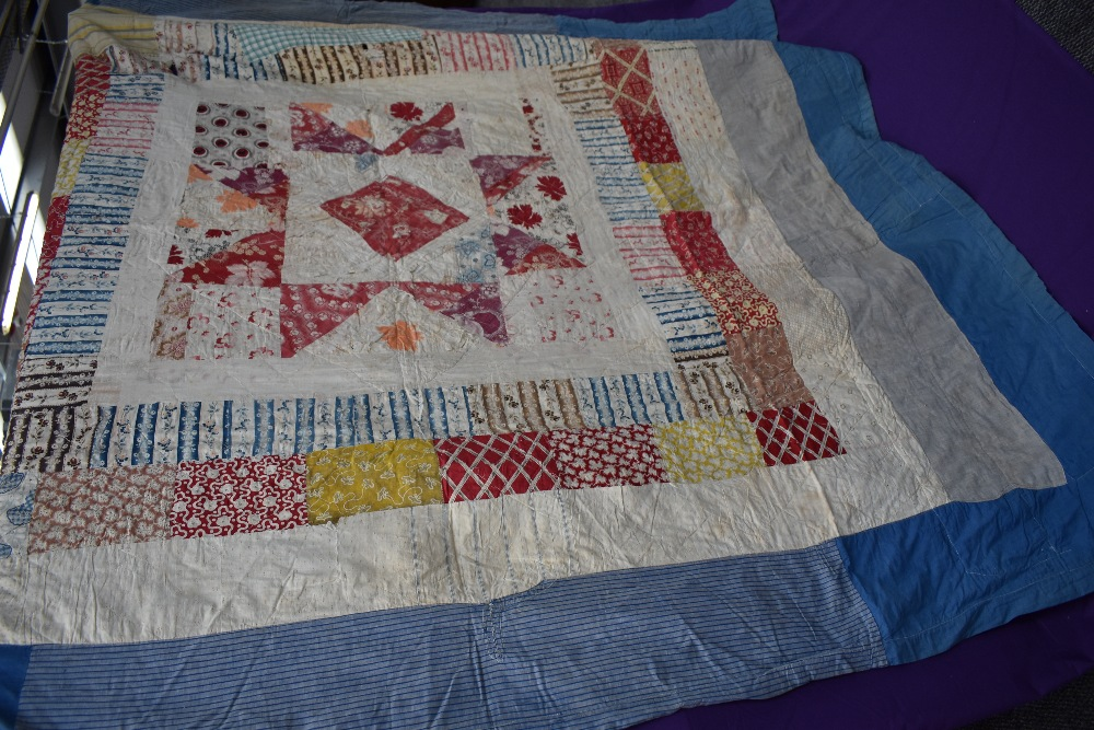Two colourful antique patchwork quilts, both having damage. - Image 2 of 7