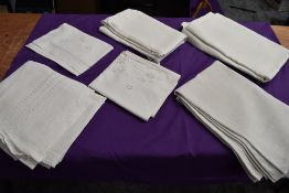 A variety of antique table linen including examples with intricate cut work, ladder work and