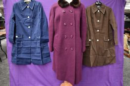 A 1960s purple wool coat with faux fur collar and two 1960s short Mac style coats, one navy the