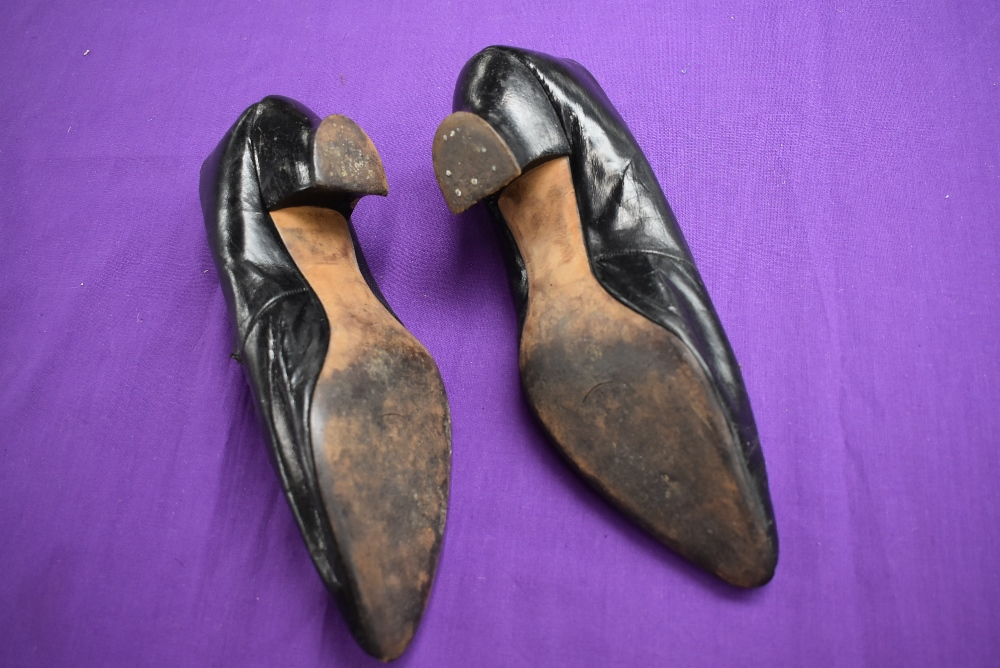 A pair of antique black leather shoes. - Image 4 of 4