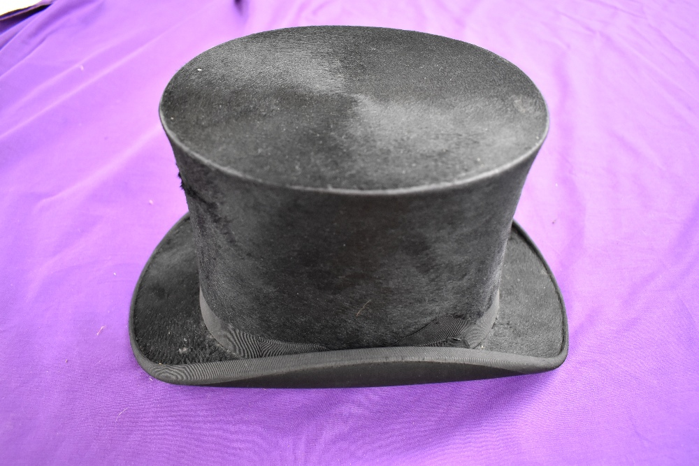 An antique top hat 'R.W.T.K Thompson Kendal' internal measurement approx 21' height approx 5.5',some