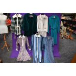A collection of vintage and retro Ladies clothing in a mixture of colours and styles, including