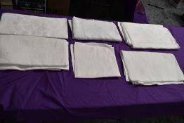 Six antique damask table cloths.