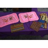 A selection of ethnic styled fabrics a vintage bag of similar style and two pink Chinese embroidered