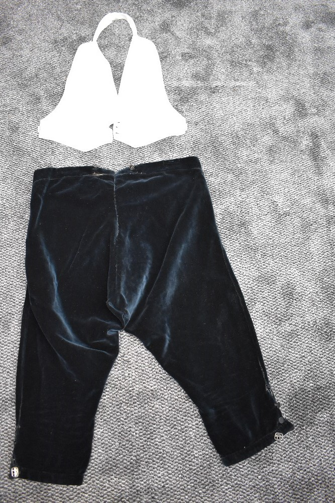 A pair of antique black velvet breeches and a marcella evening waistcoat.