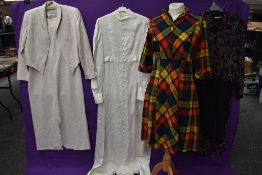 A mixed lot of clothing including 1960s wedding dress with lace detailing,tartan wool 1940s dress,