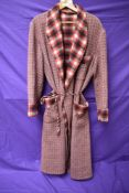 A 1940s/50s gents red wool dressing gown with cord belt,larger size, great condition.