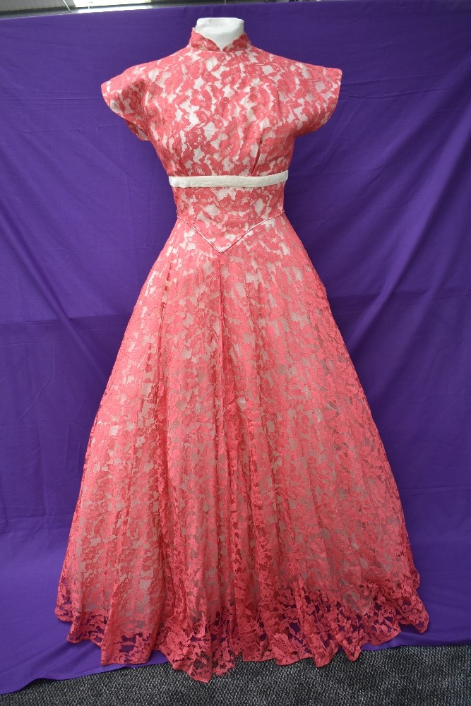 A vintage late 50s/60s pink lace dress having cream velvet band to under bust, tapered bodice into
