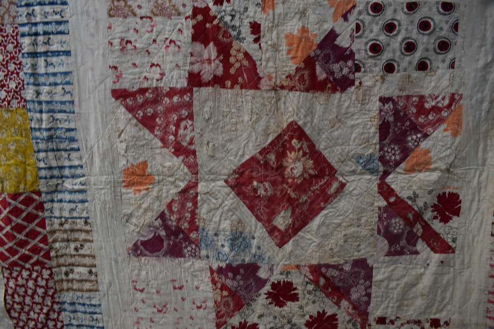 Two colourful antique patchwork quilts, both having damage. - Image 4 of 7