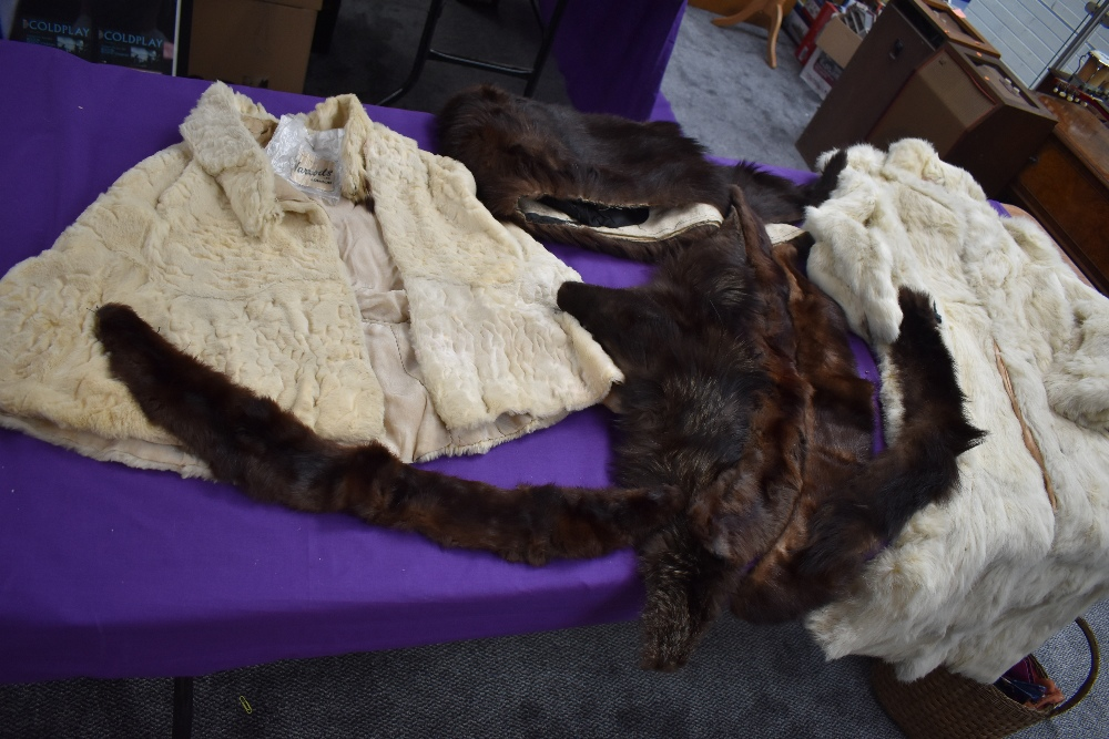 A box of vintage furs for make do and mend or repair including an ermine cape having Harrods label.