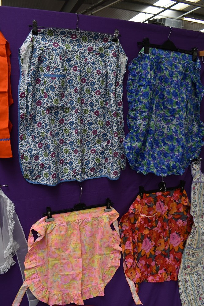 A lovely collection of aprons and overalls, some having original packaging and a lot appearing - Image 4 of 9