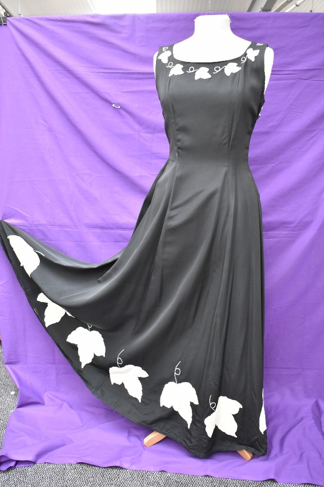 A vintage 1950s evening gown in black having cream ivy appliqué pattern and side metal zipper,