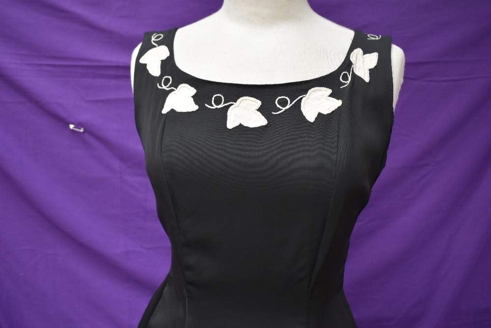 A vintage 1950s evening gown in black having cream ivy appliqué pattern and side metal zipper, - Image 2 of 8