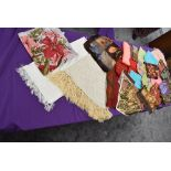 A mixture of vintage headscarves, various styles and colours,fabrics and eras.