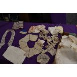 A box of vintage and antique lace collars, crotchet edging,mats,tray cloths and doilies, fabric