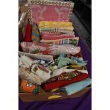 A box full of vintage and retro towels, tea towels,oven gloves and aprons including novelty and
