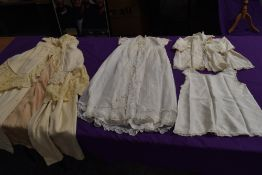 An antique wool christening shawl or similar,a tulle babies gown and more.
